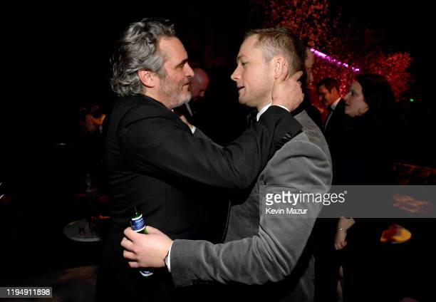 Joaquin Phoenix and Taron Egerton attend PEOPLE's Annual Screen Actors Guild Awards Gala at The Shrine Auditorium on January 19 2020 in Los Angeles...