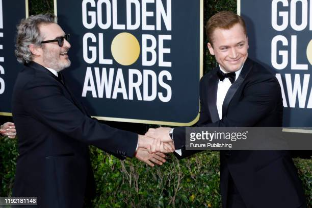 STATES JANUARY Joaquin Phoenix and Taron Egerton photographed on the red carpet of the 77th Annual Golden Globe Awards at The Beverly Hilton Hotel on...