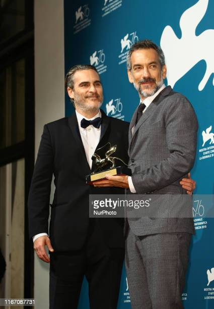 Joaquin Phoenix and Todd Phillips pose with the Golden Lion for Best Film Award for Joker at the Winners Photocall during the 76th Venice Film...