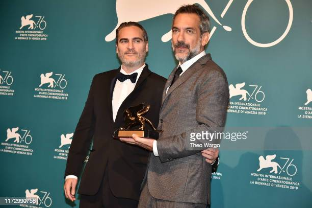 Joaquin Phoenix and Todd Phillips pose with the Golden Lion for Best Film Award for 'Joker' at the Winners Photocall during the 76th Venice Film...