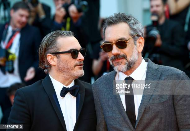 Joaquin Phoenix and Todd Phillips walk the red carpet ahead of the closing ceremony of the 76th Venice Film Festival at Sala Grande on September 07...