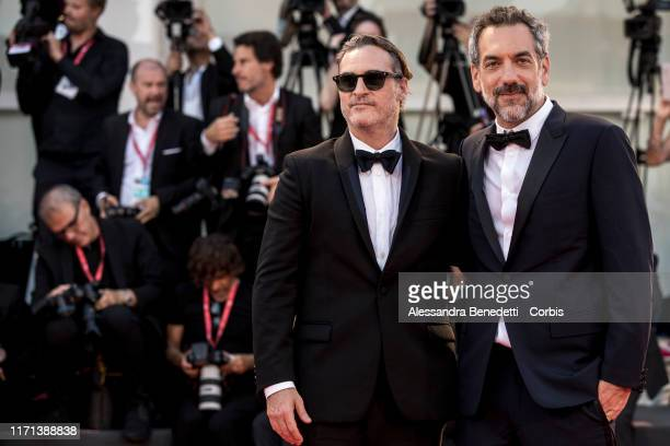 Joaquin Phoenix and Todd Phillips walk the red carpet ahead of the Joker screening during the 76th Venice Film Festival at Sala Grande on August 31...
