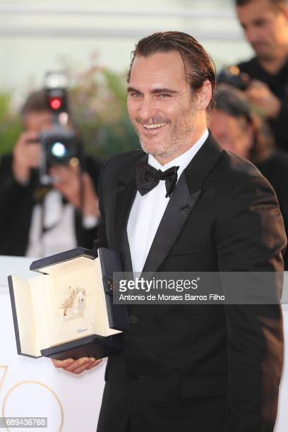 Joaquin Phoenix attends the winners photocall during the 70th annual Cannes Film Festival at Palais des Festivals on May 28 2017 in Cannes France