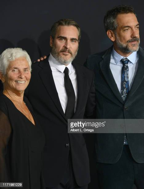 Joaquin Phoenix mother Arlyn Phoenix and Todd Phillips arrive for the Premiere Of Warner Bros Pictures Joker held at TCL Chinese Theatre IMAX on...