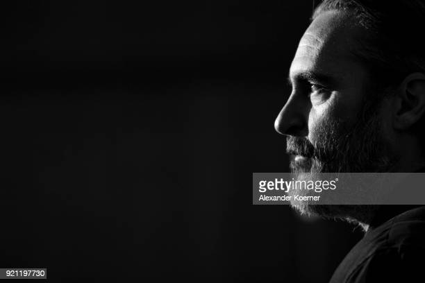 Joaquin Phoenix poses at the 'Don't Worry He Won't Get Far on Foot' photo call during the 68th Berlinale International Film Festival Berlin at Grand...