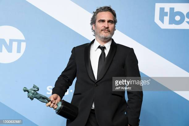 "Joaquin Phoenix poses in the press room after winning the award for Outstanding Performance by a Male Actor in a Leading Role for ""The Joker"" during..."