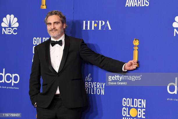 Joaquin Phoenix poses in the press room during the 77th Annual Golden Globe Awards at The Beverly Hilton Hotel on January 05 2020 in Beverly Hills...