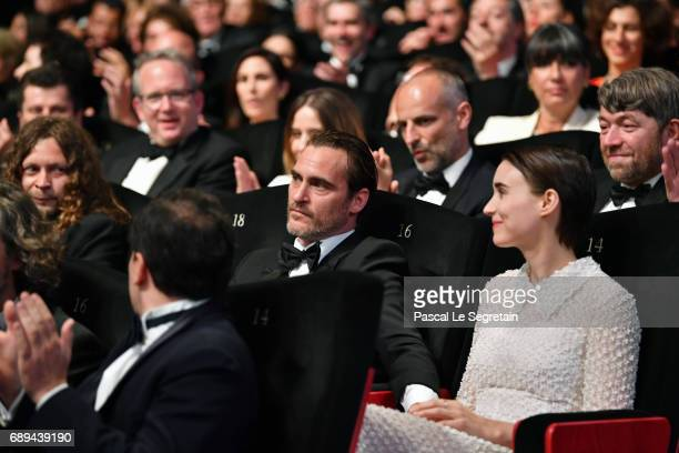 Joaquin Phoenix reacts with Rooney Mara as it is announced that he won the award for Best Actor for his part in the movie You Were Never Really Here...