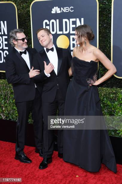Joaquin Phoenix Taron Egerton and Emily Thomas attend the 77th Annual Golden Globe Awards at The Beverly Hilton Hotel on January 05 2020 in Beverly...