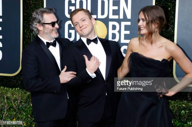 STATES JANUARY Joaquin Phoenix Taron Egerton and Emily Thomas photographed on the red carpet of the 77th Annual Golden Globe Awards at The Beverly...
