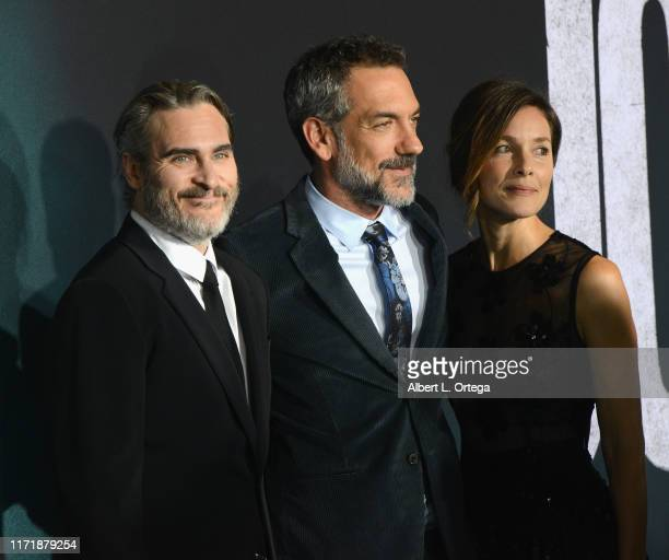 Joaquin Phoenix Todd Phillips and Alexandra Kravetz arrive for the premiere of Warner Bros Pictures Joker held at TCL Chinese Theatre IMAX on...