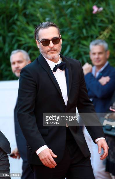 Joaquin Phoenix walks the red carpet ahead of the closing ceremony of the 76th Venice Film Festival at Sala Grande on September 07 2019 in Venice...