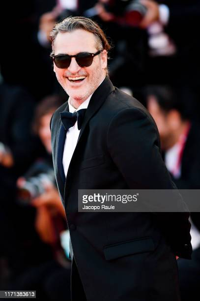 "Joaquin Phoenix walks the red carpet ahead of the ""Joker"" screening during the 76th Venice Film Festival at Sala Grande on August 31, 2019 in Venice,..."
