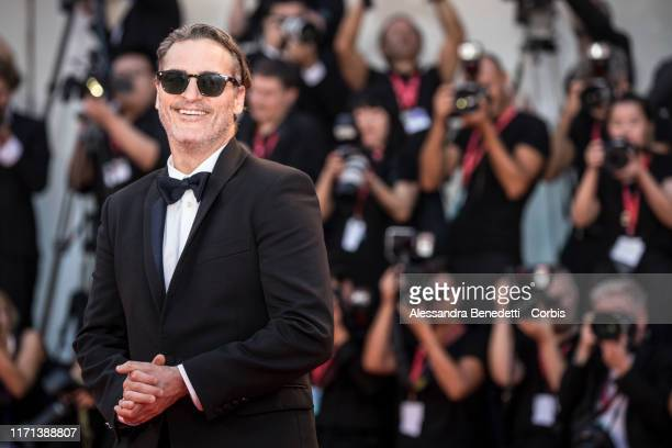 """Joaquin Phoenix walks the red carpet ahead of the """"Joker"""" screening during the 76th Venice Film Festival at Sala Grande on August 31, 2019 in Venice,..."""