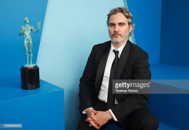 Joaquin Phoenix winner of Outstanding Performance by a Male Actor in a Leading Role in a Motion Picture award for 'Joker' poses in the Winners'...