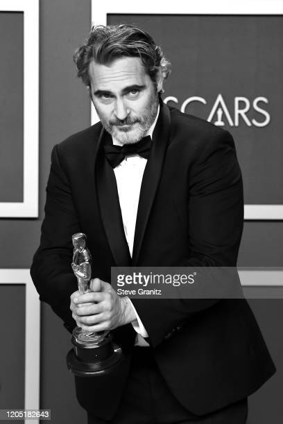 """Joaquin Phoenix, winner of the Actor in a Leading Role award for """"Joker,"""" poses in the press room during poses in the press room during the 92nd..."""