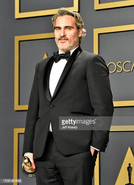 """Joaquin Phoenix, winner of the Actor in a Leading Role award for """"Joker,"""" poses in the press room during the 92nd Annual Academy Awards at Hollywood..."""