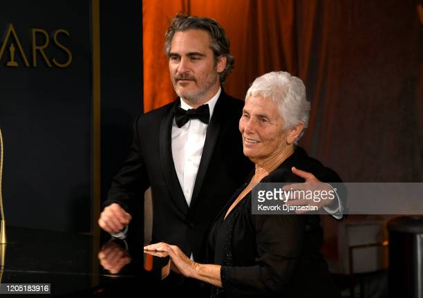 """Joaquin Phoenix, winner of the Actor in a Leading Role award for """"Joker,"""" and Arlyn Phoenix attend the 92nd Annual Academy Awards Governors Ball at..."""
