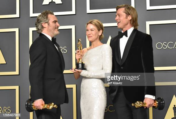 Joaquin Phoenix winner of the Actor in a Leading Role award for Joker Renée Zellweger winner of the Actress in a Leading Role award for Judy and Brad...
