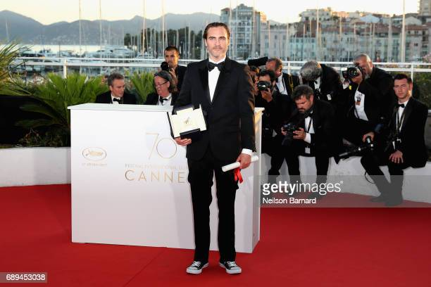 Joaquin Phoenix winner of the award for Best Actor for his part in the movie 'You Were Never Really Here' attends the Palme D'Or winner photocall...