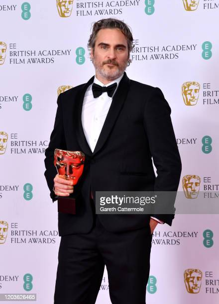 """Joaquin Phoenix with his Best Actor award for """"The Joker' poses in the Winners Room during the EE British Academy Film Awards 2020 at Royal Albert..."""