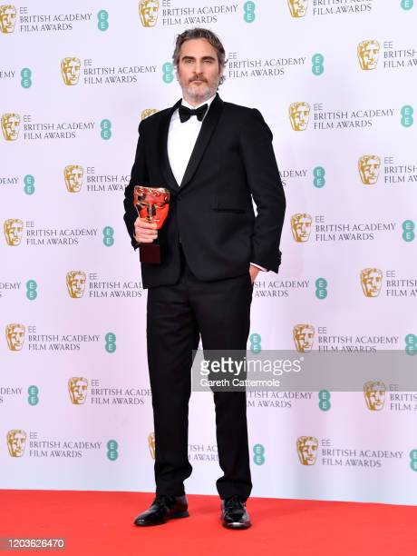 Joaquin Phoenix with his Best Actor award for The Joker' poses in the Winners Room during the EE British Academy Film Awards 2020 at Royal Albert...