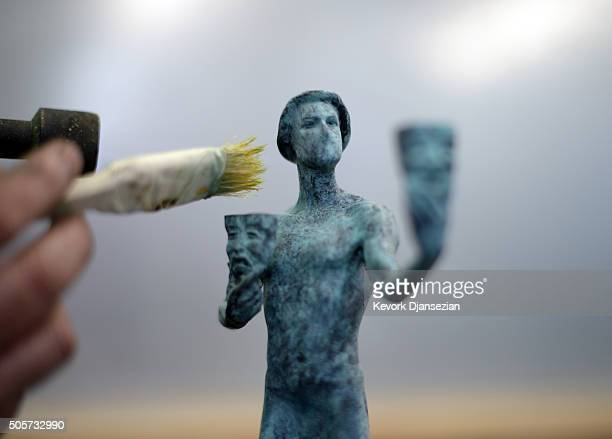 Joaquin Quintero applies a greenblack patina to one of the bronze Screen Actors Guild Award statuettes at the American Fine Arts Foundry in...