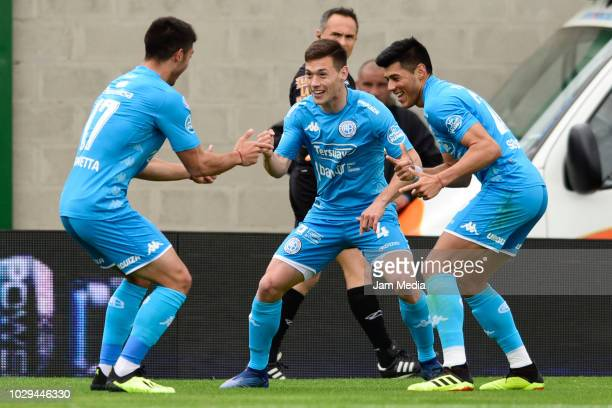 Joaquin Rikemberg of Belgrano celebrates after scoring the opening goal with the teammates Leonardo Sequeira and Tomas Guidara during a match between...