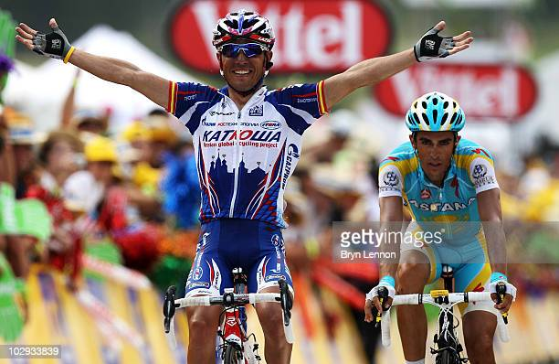 Joaquin Rodriguez of Spain and Team Katusha celebrates as he beats compatriot Alberto Contador of the Astana team to the finishline during stage...