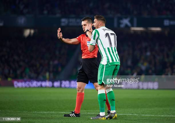 Joaquin Sanchez of Real Betis argues with referee Carlos del Cerro Grande during the Copa del Semi Final first leg match between Real Betis and...