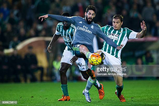 Joaquin Sanchez of Real Betis Balompie competes for the ball with Francisco Roman Alarcon alias Isco of Real Madrid CF during the La Liga match...