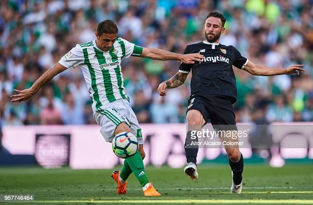 Joaquin Sanchez of Real Betis Balompie competes for the ball with Miguel Layun of Sevilla FC during the La Liga match between Real Betis and Sevilla...