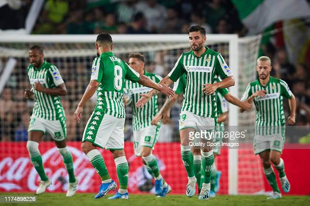 Joaquin Sanchez of Real Betis celebrates scoring his team's opening goal with team matesduring the Liga match between Real Betis Balompie and Getafe...