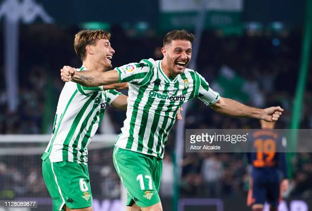 Joaquin Sanchez of Real Betis celebrates with his teammates Sergio Canales of Real Betis after scoring his team's second goal during the Copa del...