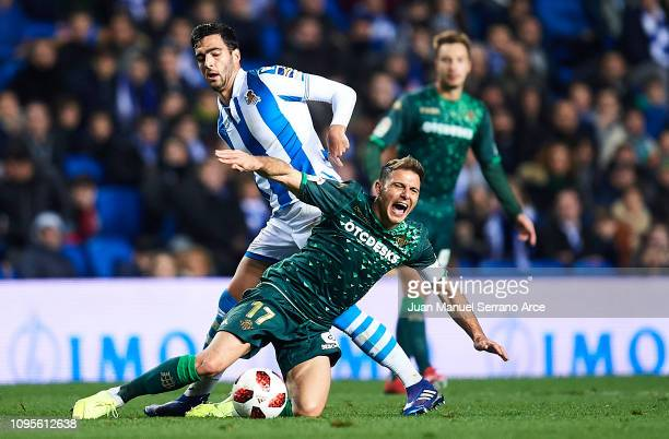 Joaquin Sanchez of Real Betis duels for the ball with Mikel Merino of Real Sociedad during the Copa del Rey Round of 16 second leg match between Real...
