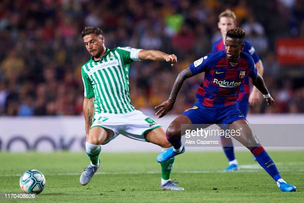 Joaquin Sanchez of Real Betis fights for the ball with Nelson Semedo of FC Barcelona during the Liga match between FC Barcelona and Real Betis...