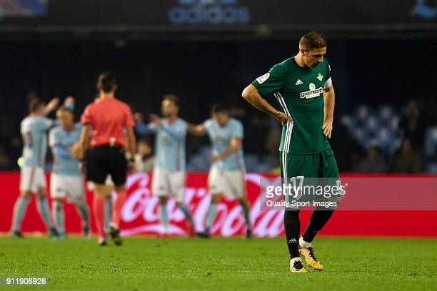 Joaquin Sanchez of Real Betis reacts after Iago Aspas of Celta de Vigo scored the third goal during the La Liga match between Celta de Vigo and Real...