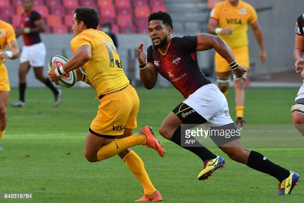 Joaquin Tuculet fullback of the Jaguares runs past Berton Klaasen of the Southern kings during the Super XV rugby match between South African...