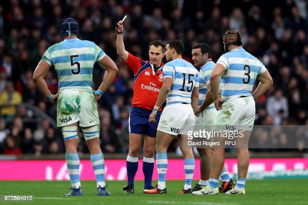 Joaquin Tuculet of Argentina is shown a yellow card by the referee during the Old Mutual Wealth Series match between England and Argentina at...