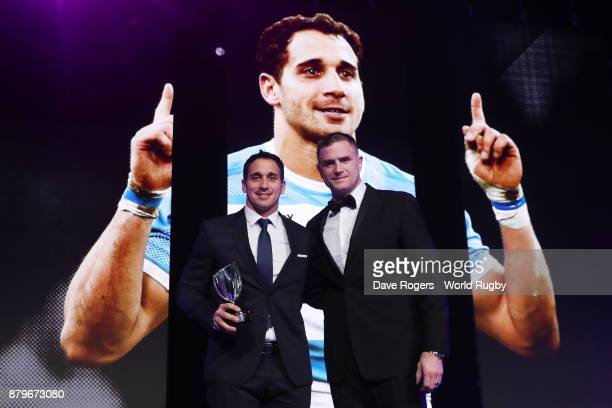Joaquin Tuculet of Argentina receives the IRPA Try of the Year Award from Jamie Heaslip of Ireland during the World Rugby Awards 2017 in the Salle...