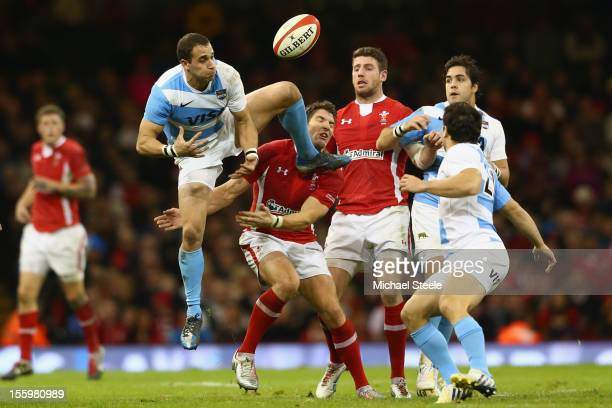 Joaquin Tuculet of Argentina spills a high ball under pressure from James Hook of Wales during the Wales versus Argentina International match at the...
