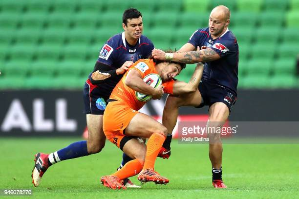 Joaquin Tuculet of the Jaguares is tackled by Bill Meakes and Melbourne Rebels defence during the round nine Super Rugby match between the Rebels and...