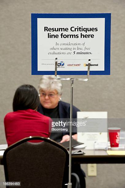 A job applicant front listens to Linda Hamilton during a resume review during a HIREvent job fair in Concord California US on Tuesday Nov 13 2012 The...