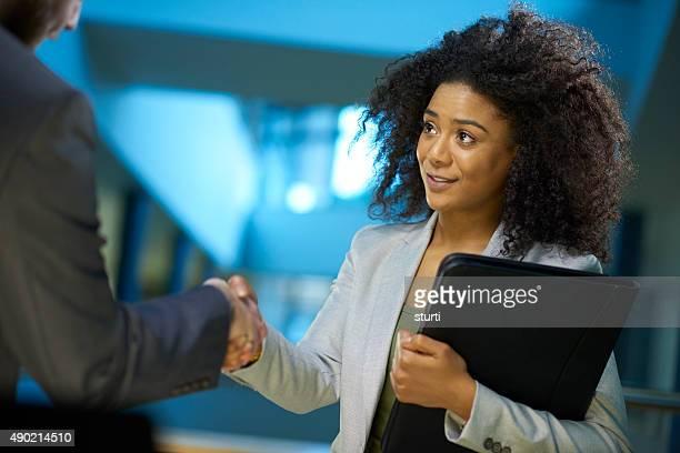 job applicant shaking hands .