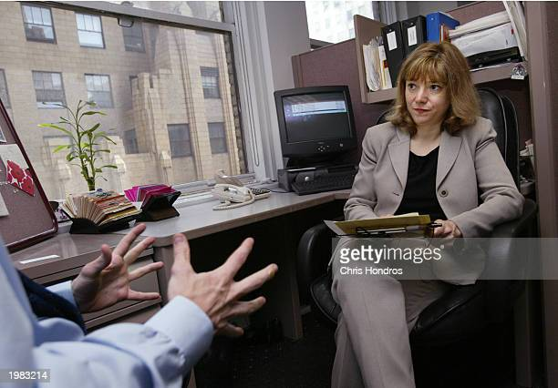 A job applicant speaks with recruiter Renee Chandler during an interview May 7 2003 at the offices of Metro Support Group in New York City The...