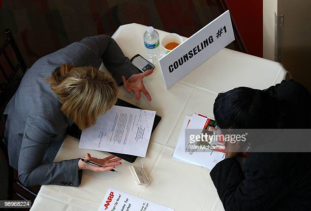 Job applicants are counseled with career advice during a jobs fair at Nationals Park cohosted by the AARP May 11 2010 in Washington DC The US economy...