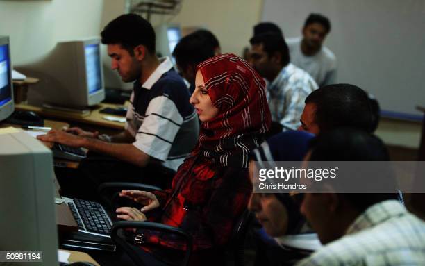 Job applicants fill out their resumes on computers on June 21 2004 at the Ministry of Labour in Baghdad Iraq The Labour Ministry has taken about...