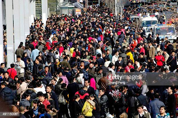 A job fair for college graduates in Beijing China has issued new rules making it harder to fire workers in an effort to stem rising unemployment...