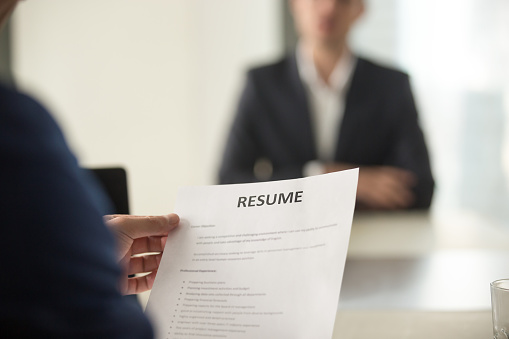 Job interview in office, focus on resume, close up view 804671778