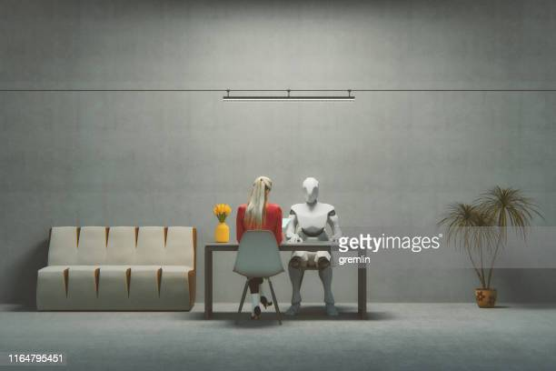 job interview with futuristic cyborg - robot stock pictures, royalty-free photos & images